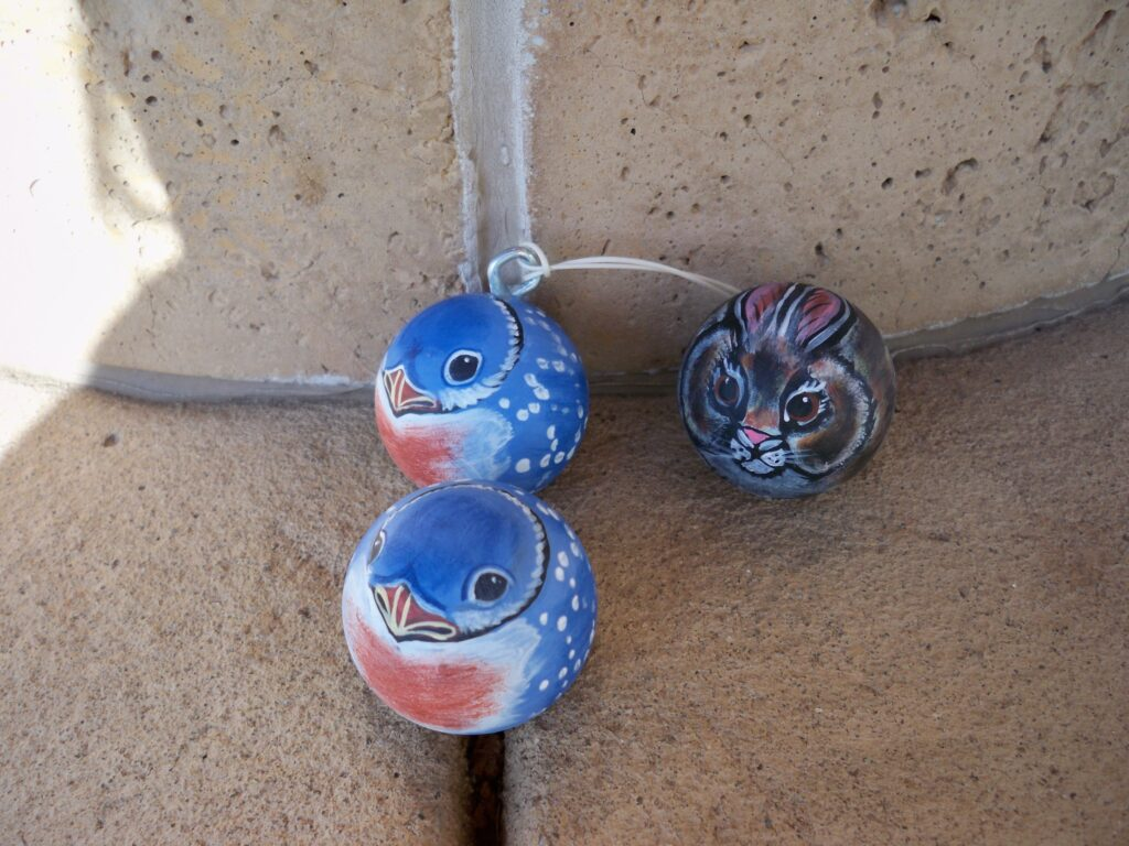 Painted rock, bird ornament, ping pong, tuzi williams